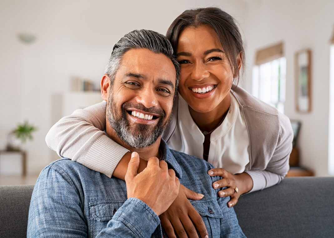 smiling middle aged south asian couple